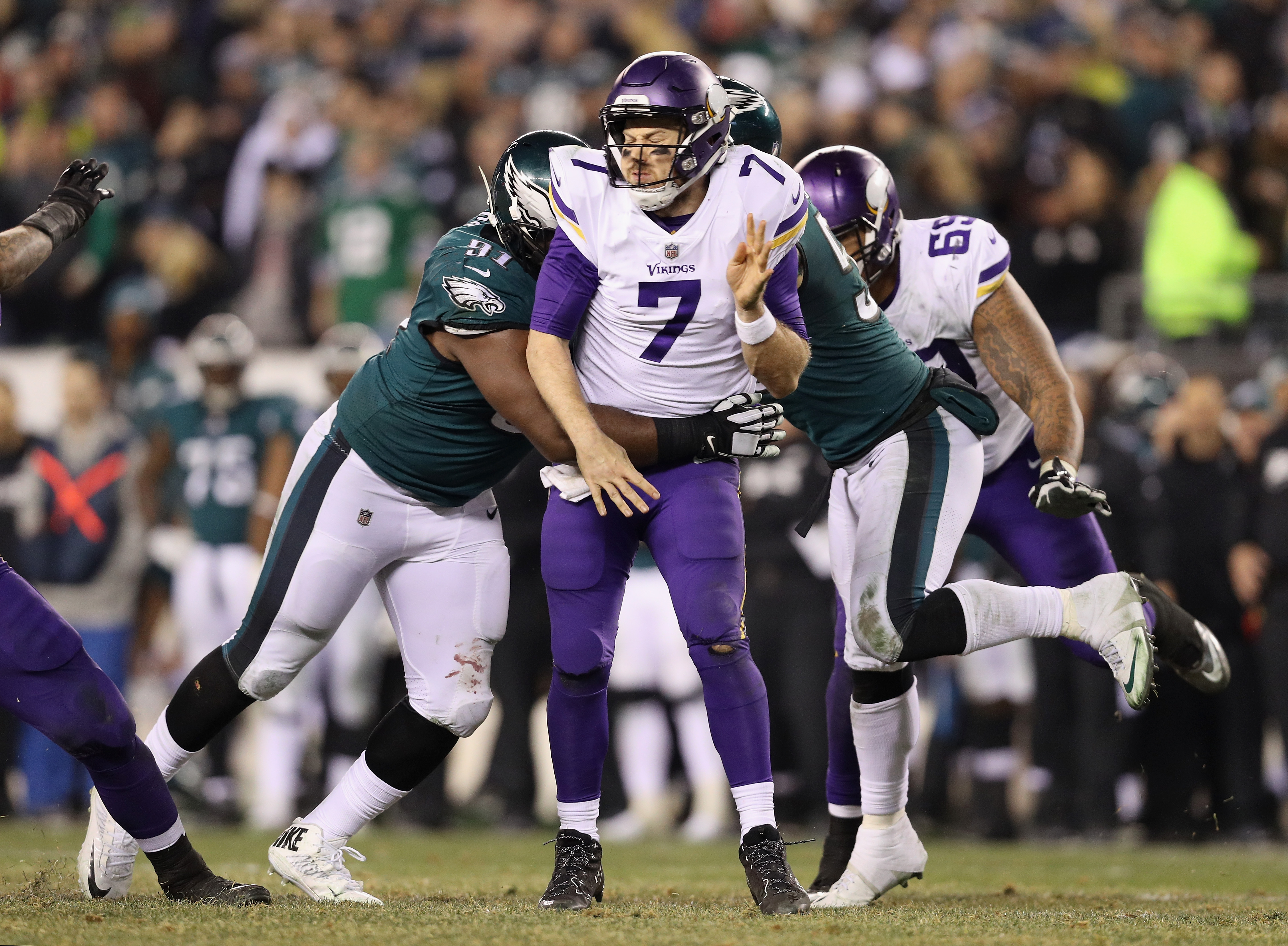 Philadelphia Pa January  Case Keenum  Of The Minnesota Vikings Is Tackled By Fletcher Cox  Of The Philadelphia Eagles During The Fourth Quarter